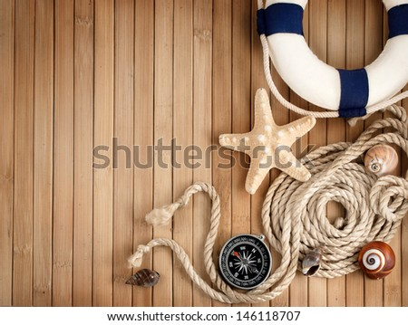 Few summer marine items on a wooden background.