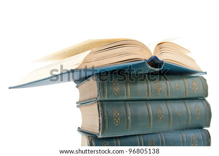 Few toms vintage books, on of them is opened. Isolated on white background.