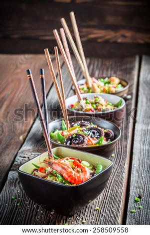 Few traditional asian noodles with vegetables - stock photo