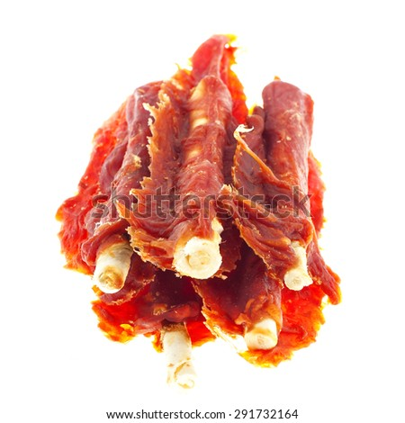 Few treats for dogs (meat, rawhide, bone) isolated on white background - stock photo
