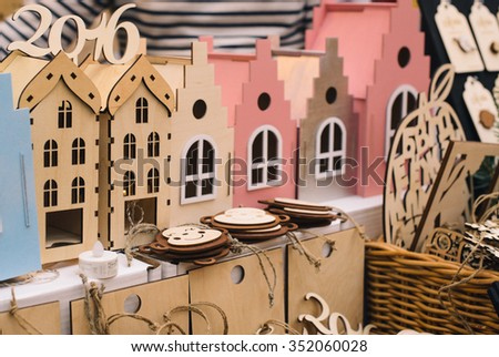 Few wood toy houses in a row - stock photo