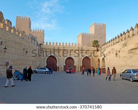 Fez, Morocco - December 14, 2015: Moroccan citizens in a relaxation quotidian scene in Bab Makina Plaza. Fez El Jedid, Morocco. North Africa.