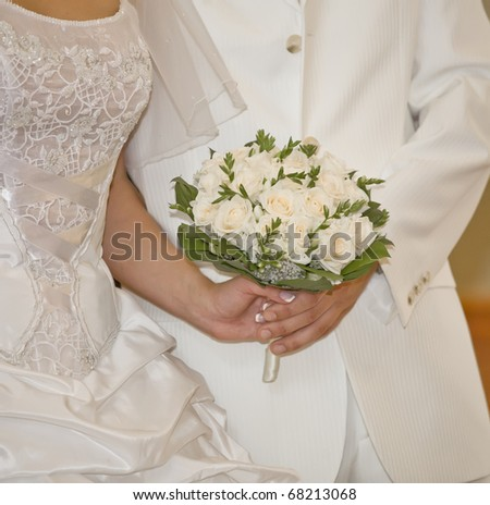 Fiance and bride hold wedding  bouquet
