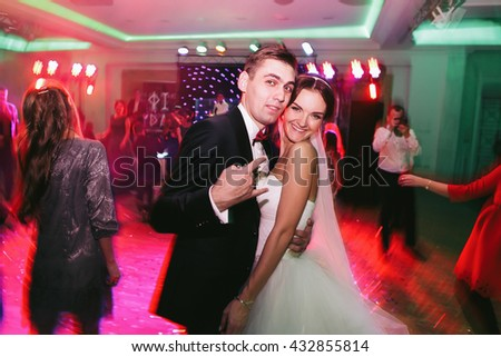 Fiance playing fool while dancing with a bride