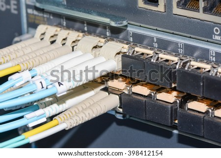 fiber optic cable plugged to network device