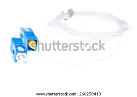 Fiber optic cable with connectors on white background - stock photo