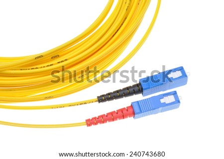 Fiber optic cables with SC plugs isolated on white background - stock photo