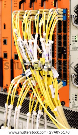 Fiber optic connecting on core network swtich - stock photo