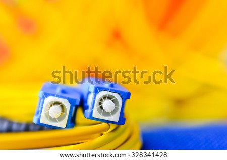 Fiber optic connectors close up on a colourful background. - stock photo