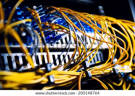 Fiber-optic equipment in a data center - stock photo