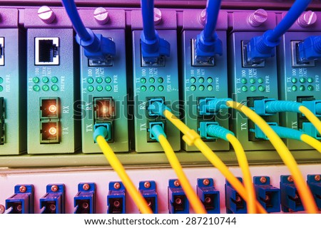 Fiber optic equipment in a data center - stock photo