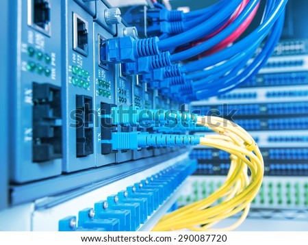 Fiber optic equipment in a data center - stock photo