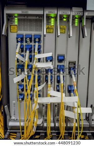 fiber optic Network Server room . network cables and servers in a technology data center . blank text label - stock photo