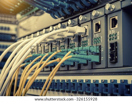 fiber optic switchboard with wires - stock photo