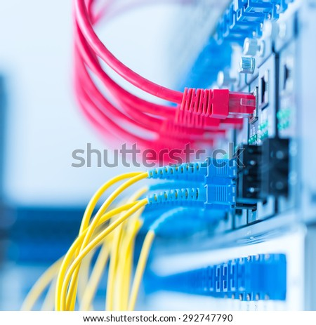 fiber optical network cables patch panel and switch - stock photo