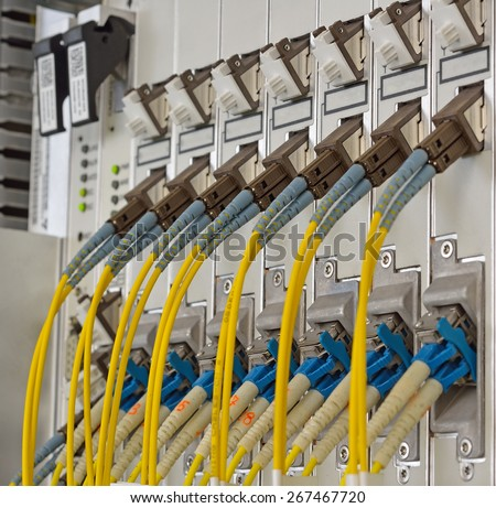 Fiber Optics with SC/LC connectors. Internet Service Provider equipment. Focus on fiber optic cables. Data Network Hardware Concept. - stock photo