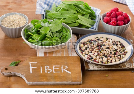 Fiber rich foods on wooden board. Healthy eating - stock photo