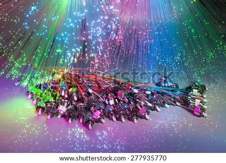 fibre optics on a technology background - stock photo