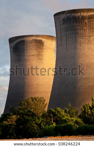 Fiddler's Ferry coal burning power station, England. Cooling towers in the evening light with trees in the foreground - stock photo