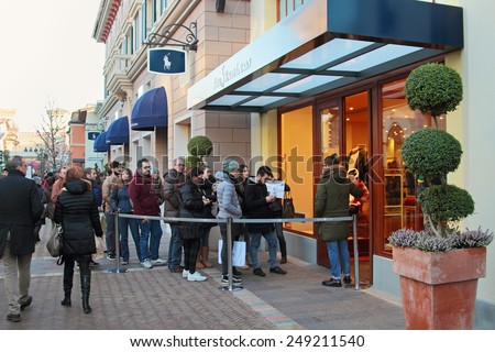 FIDENZA, ITALY - JANUARY 3, 2015: People lining up at Ralph Lauren store. Winter sale season in Fidenza outlet village, Italy on January 3, 2015. - stock photo