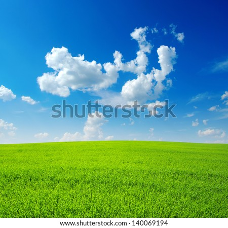 field and clouds - stock photo