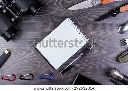 Field-glass, knife, turisticheksy set, small lamp, - stock photo