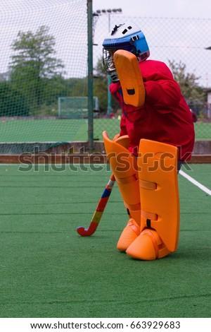 stock-photo-field-hockey-goalie-in-pract