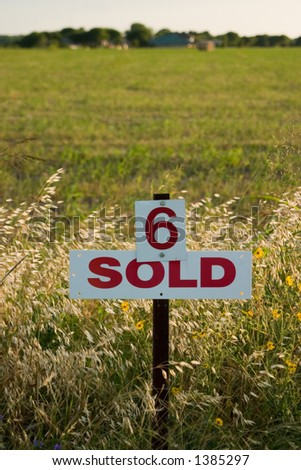 Field marked as number 6 has been sold. - stock photo