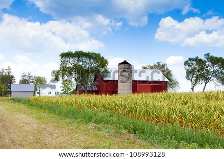 Field with Farm Buildings in the background - stock photo