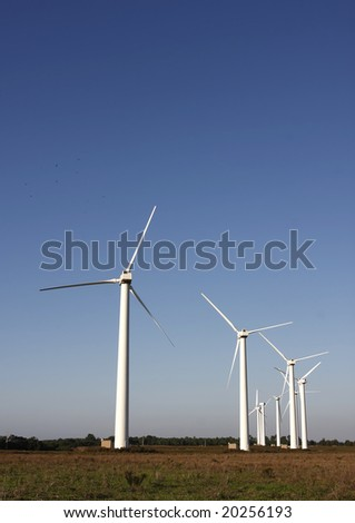 Field with wind energy converters; alternative energy generation;