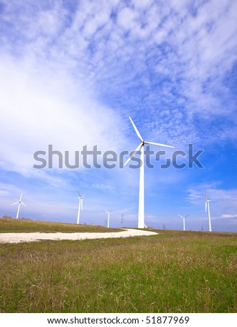 Field with wind energy converters. alternative energy generation concept