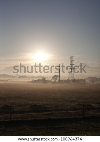 Fields and power lines near Cape Town, South Africa - stock photo