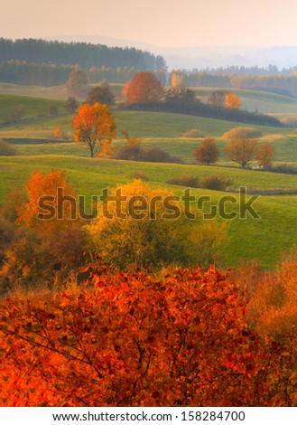 Fields in Autumn Colours -the beauty of autumn fields of Warmia - Poland - stock photo
