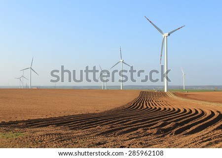 Fields with wind turbines to generating electricity - stock photo