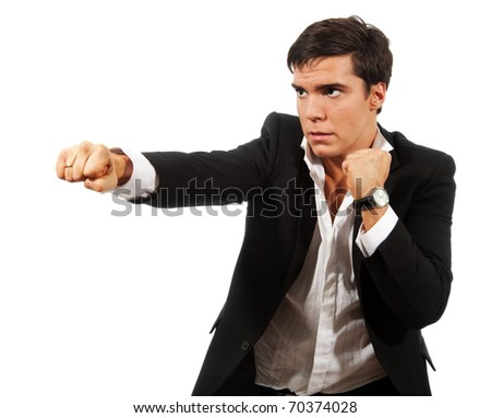 Fierce competition - business man fighting with fists wearing suit, isolated on white