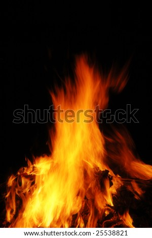 Fiery hot flame blazing with dark background