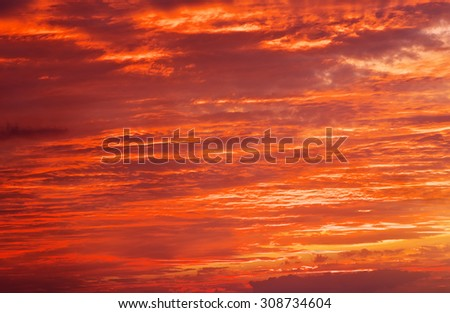Fiery orange sunset sky. Bright orange, red and yellow colors sunset sky. Light after the sunset - stock photo