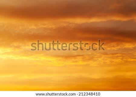 Fiery orange sunset sky Dramatic golden sky at the sunrise background - stock photo