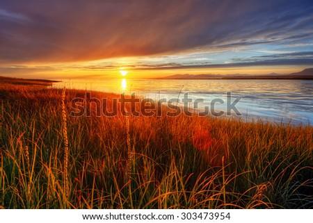 Fiery sun illuminating everything - stock photo