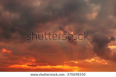 fiery sunset in the storm clouds. bad weather - stock photo