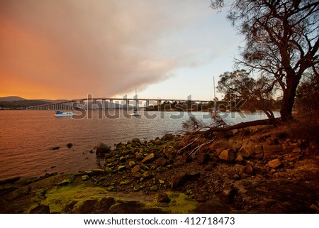 Fiery sunset on the River Derwent in Hobart, Tasmania, with Mount Wellington in background