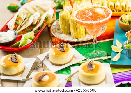 Fiesta party buffet table with dulce de lecheand other traditional Mexican food. - stock photo