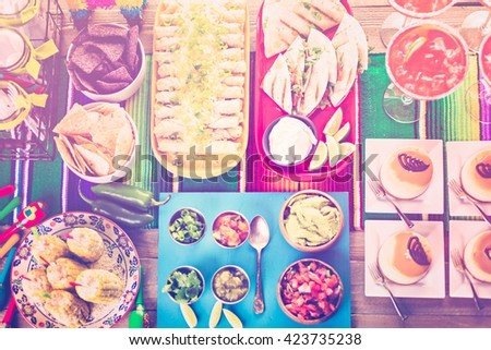 Fiesta party buffet table with traditional Mexican food. - stock photo