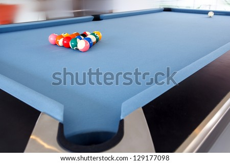 Fifteen billiard spheres lay on blue cloth - stock photo