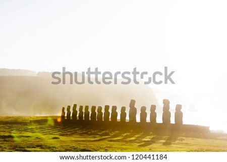 Fifteen standing moai at sunrise in Easter Island in morning mist - stock photo