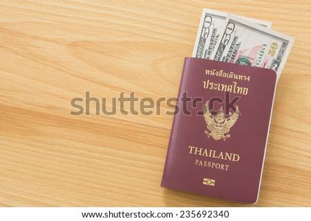 fifty dollar bills thai passport - stock photo
