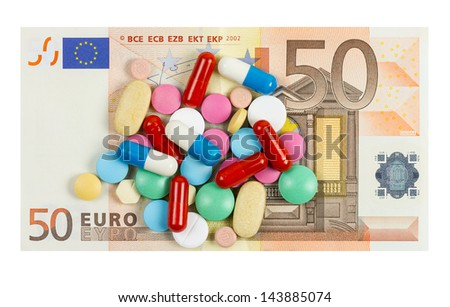 Fifty euro banknote with pills on it isolated on white background - stock photo