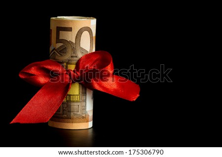 Fifty Euro Banknote  with Red Ribbon, Money as a Gift - Space for text, isolated on Black Background - stock photo