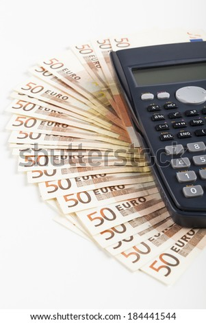 Fifty Euro banknotes with Black calculator isolated on white - stock photo