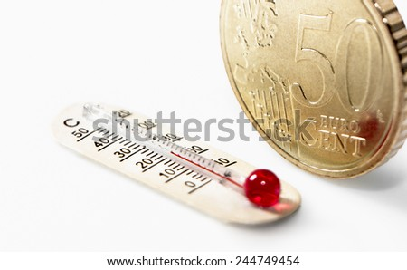 Fifty euro cent and a thermometer showing celsium and fahrenheit temperature - stock photo